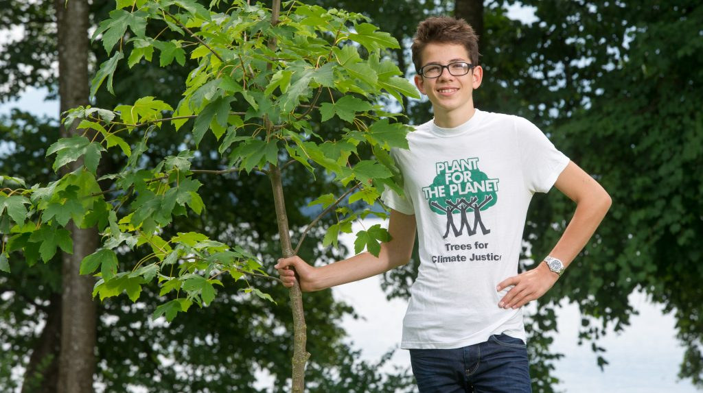 The founder of the environmental organisation and action group 'Plant for the Planet' poses next to a young tree in Uffing, Germany, 26 July 2014. Apart from Finkbeiner's committment 'Plant for the Planet' which encourages children around the world to plant tree for environmental protection, he is also committed to putting through the right to vote for minors in Germany. Photo: 26 July 2014. Photo: Tobias Hase/dpa