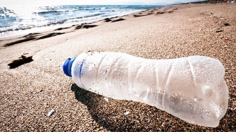 empty bottle at a beach in italy - grado